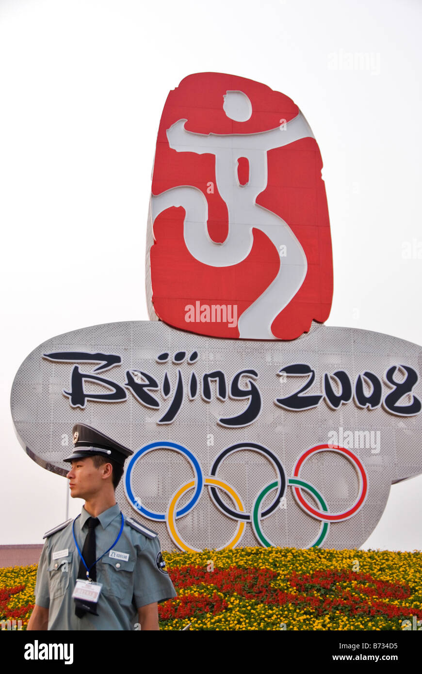 Beijing Olympics Symbol In Tiananmen Square Guarded By A Policeman