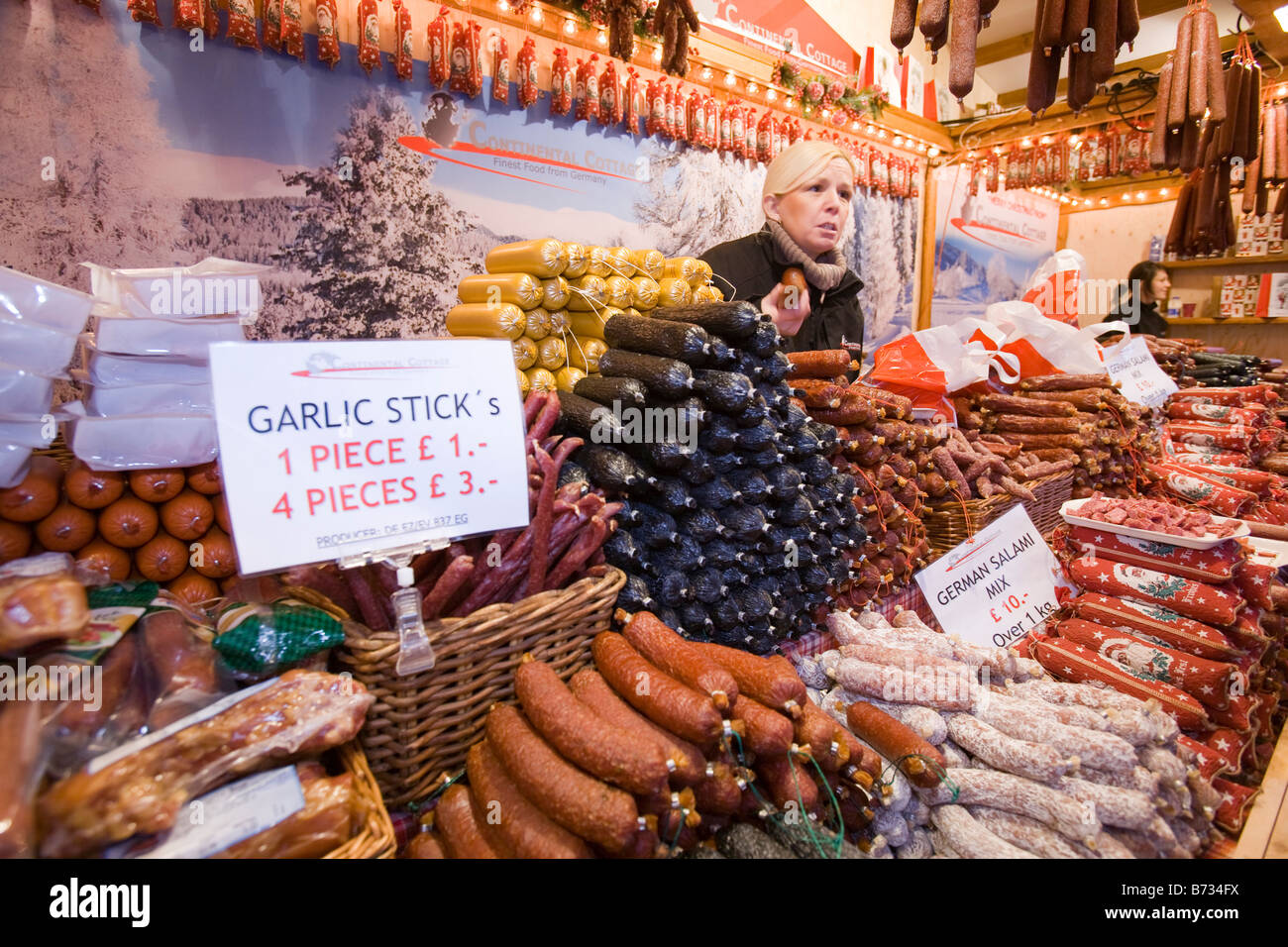 German sausages on a stall at the Christmas market outside Manchester Town Hall in Manchester UK - Stock Image