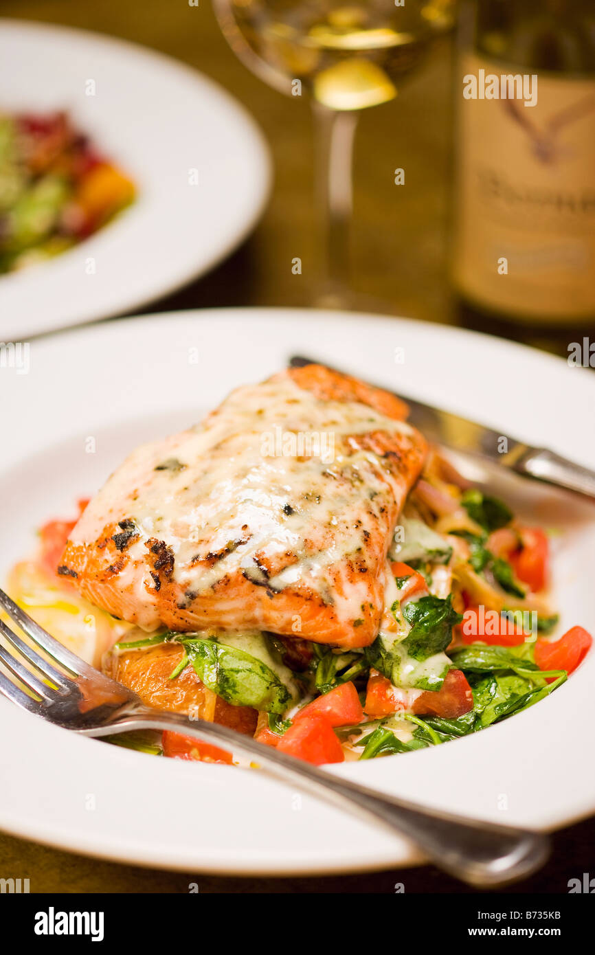 Cafe Salmon and a glass of chardonnay wine Los Olivos Cafe and Wine Merchant Los Olivos Santa Ynez Valley California - Stock Image