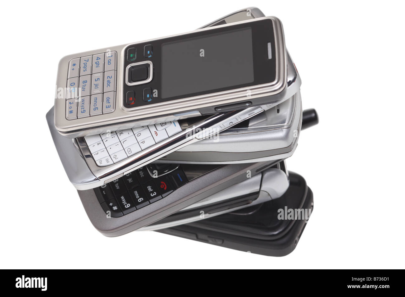 Pile of cell phones cut out on white background - Stock Image
