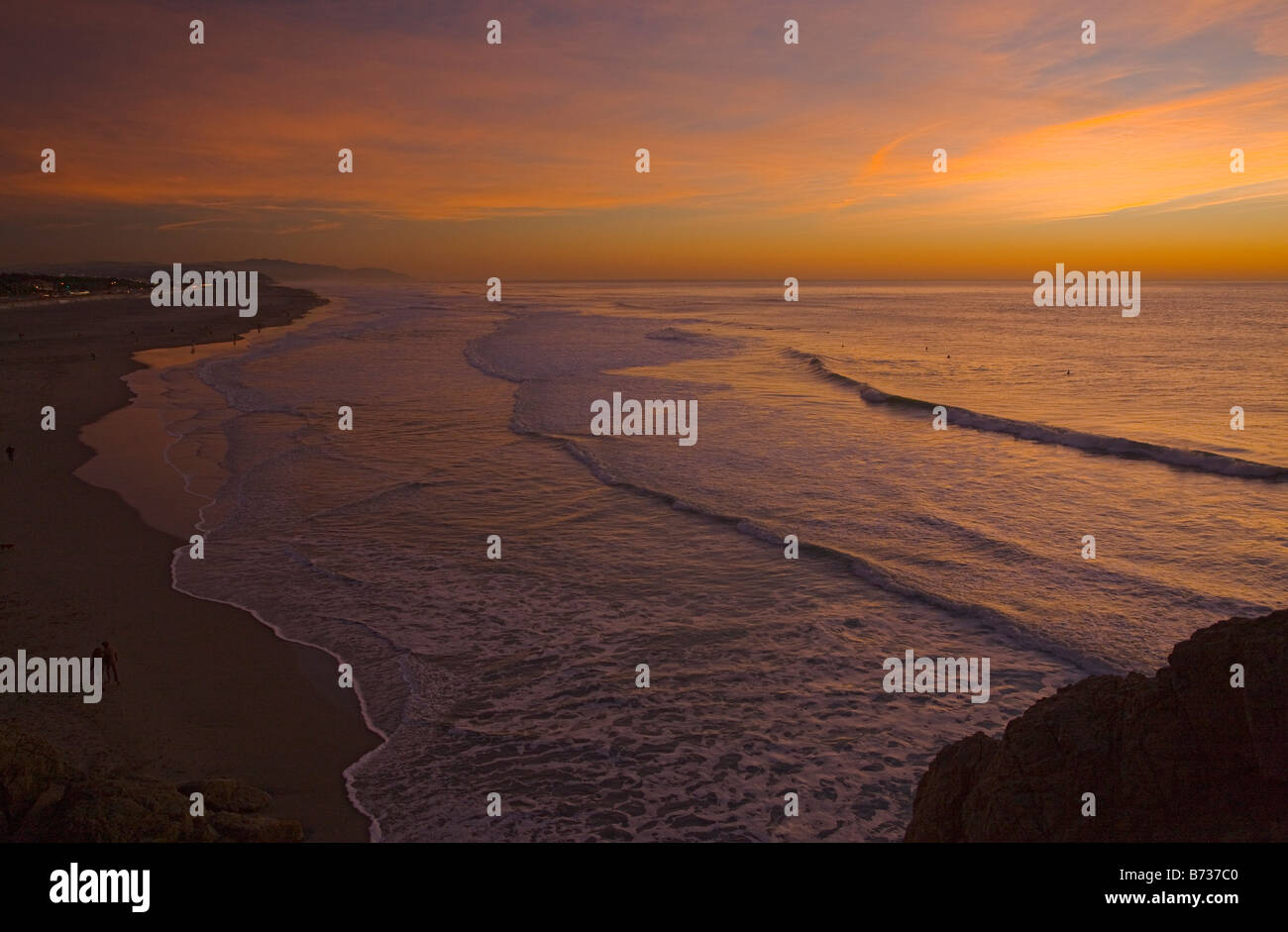 Ocean Beach at sunset well-known surfers beach on the Pacific Ocean coast of San Francisco central north California - Stock Image
