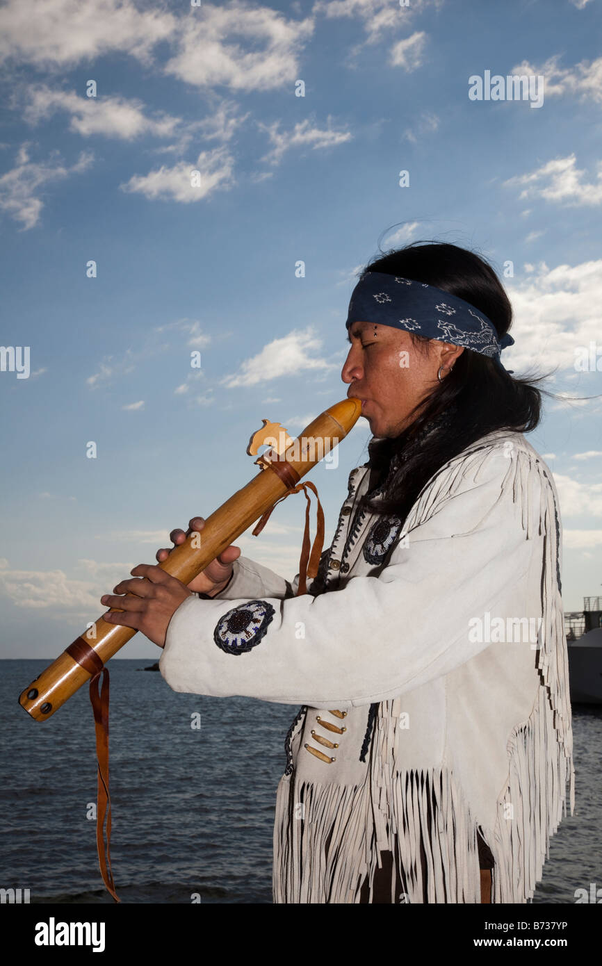 Aztec, or Peruvian Street Musicians in National Costume Playing South American flute musical  instruments  Soul Stock Photo