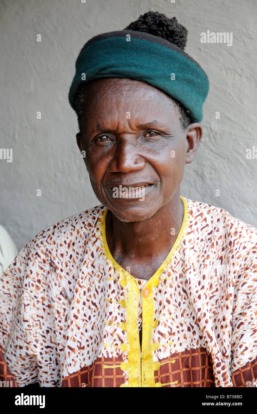 Liberian man in best shirt and hat Zolowee Nimba County - Stock Image