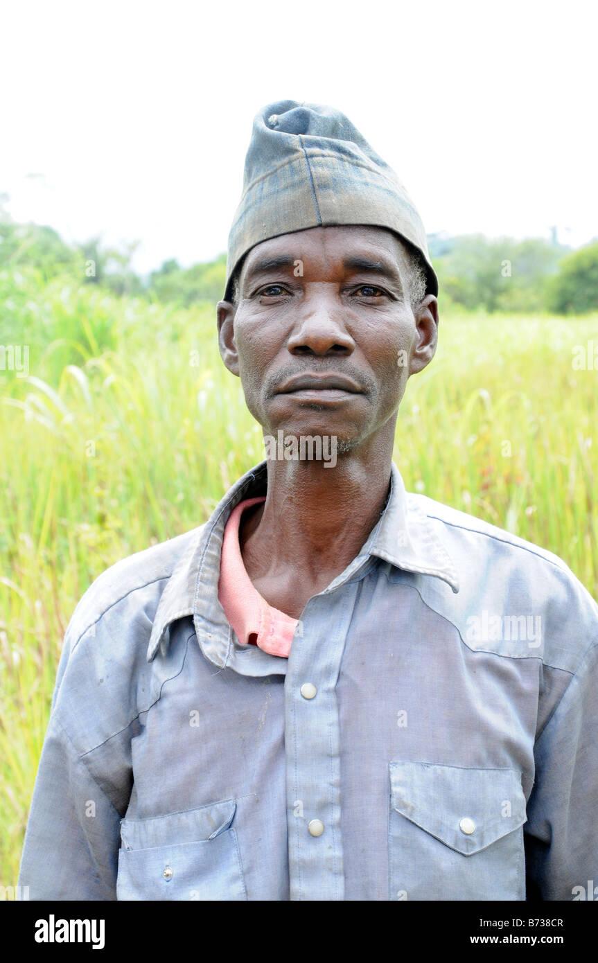 Liberian man in shirt and cap near Grassfield Nimba County - Stock Image