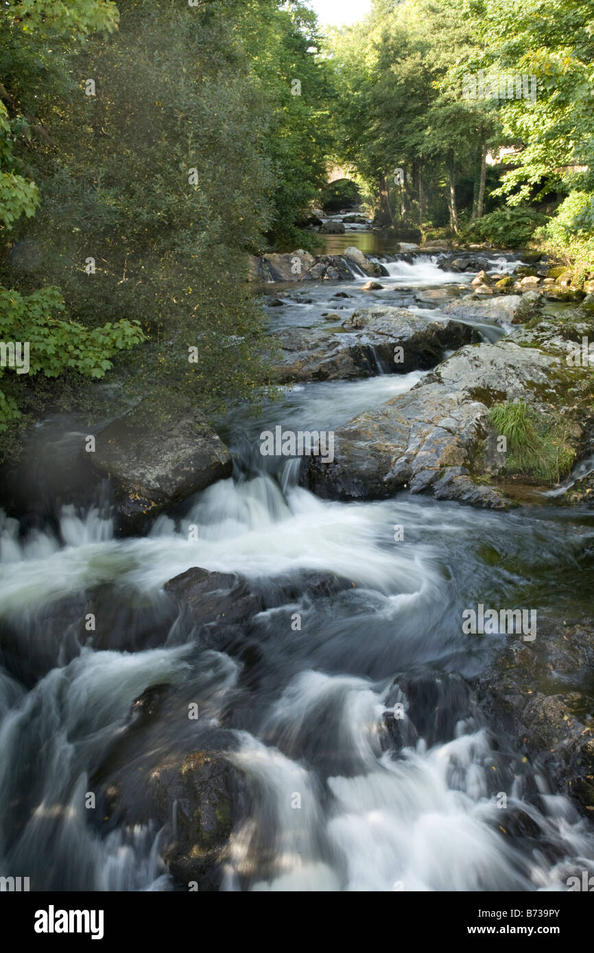 The River Erme cascading over boulders in Ivybridge, Devon. - Stock Image