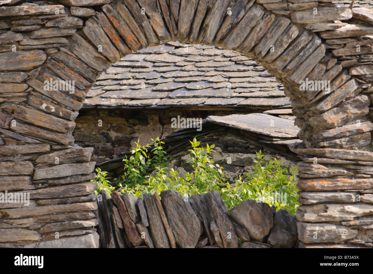 Entrance stoned arch to an old farm, Pyrenees, Spain Stock Photo