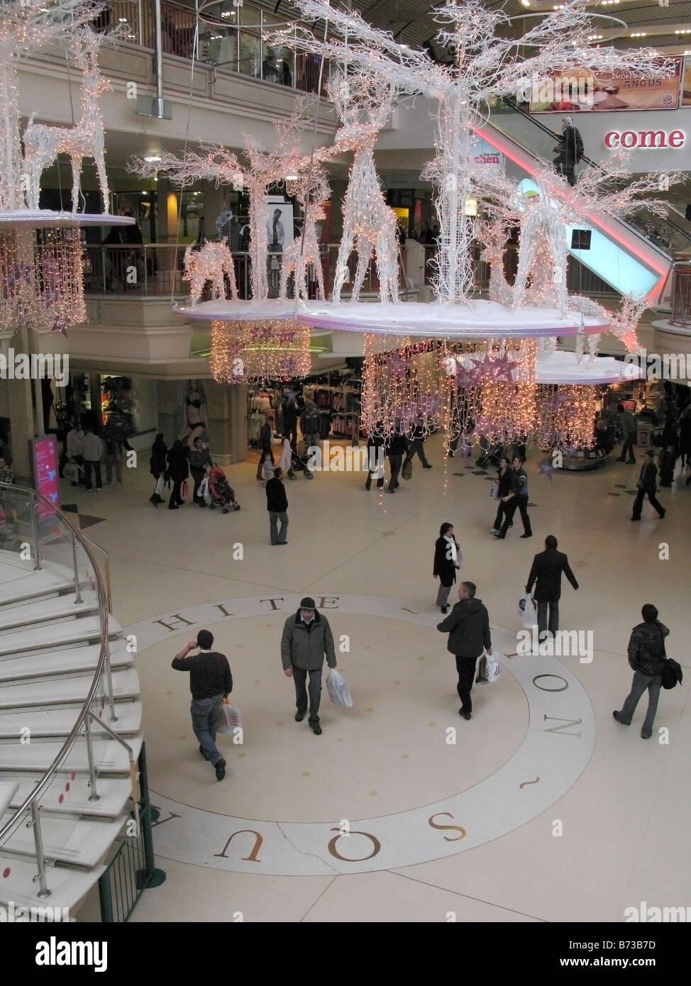People fussing around Castle Mall during Christmas period, Norwich UK - Stock Image