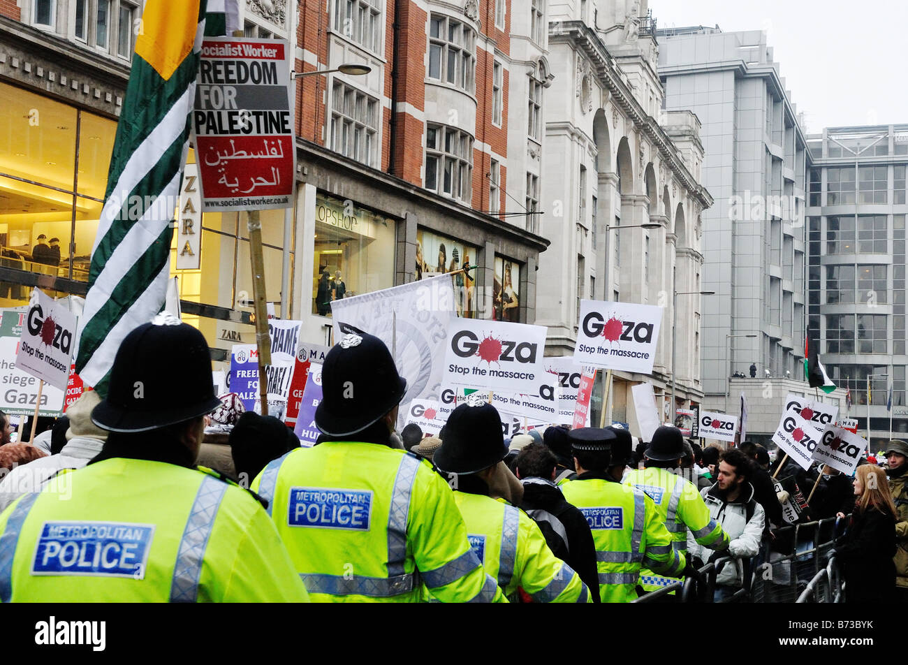 Anti-Israel Gaza massacre protesters march past the Israel Embassy, London, UK - Stock Image