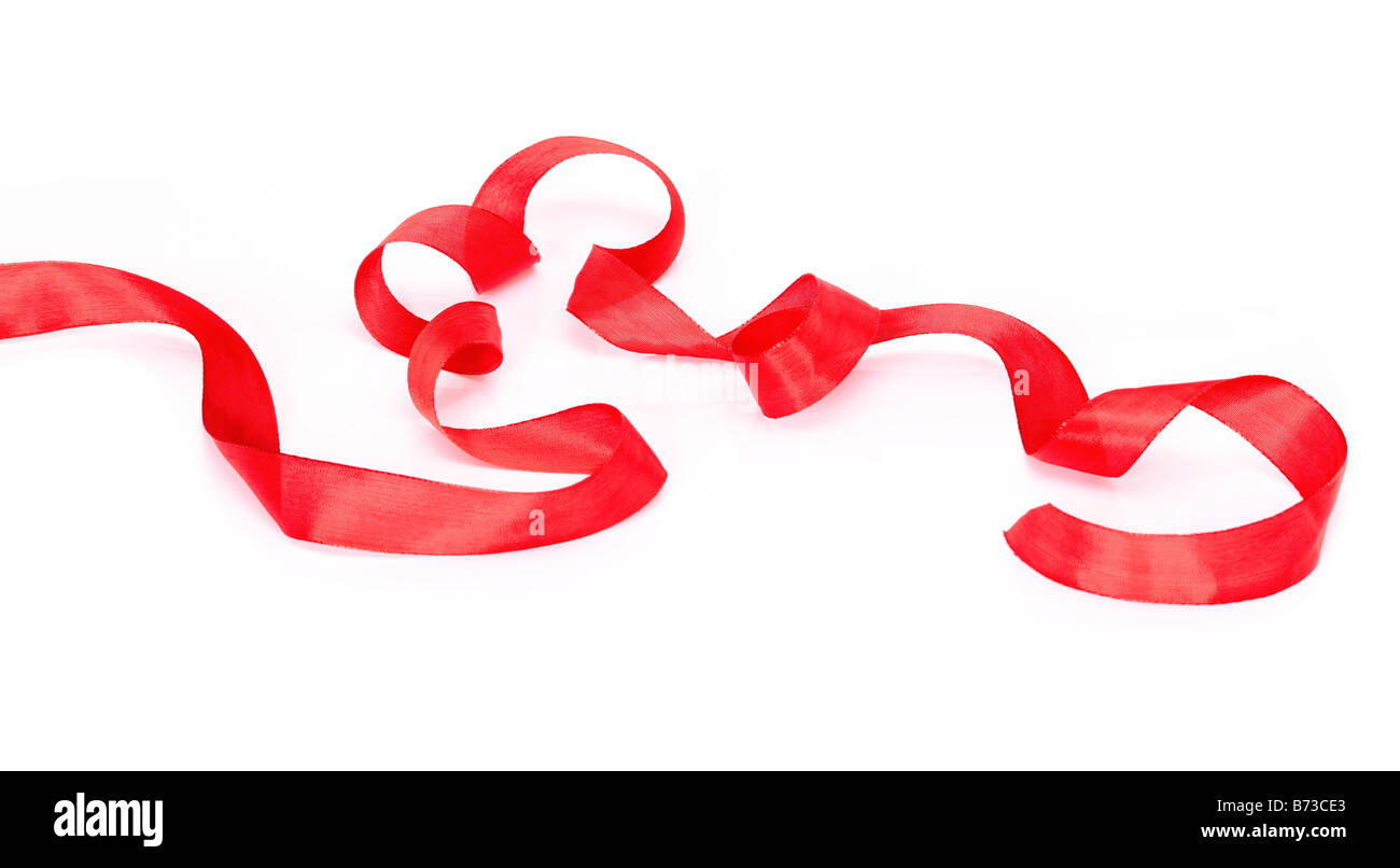 Red ribbon isolated on white background - Stock Image