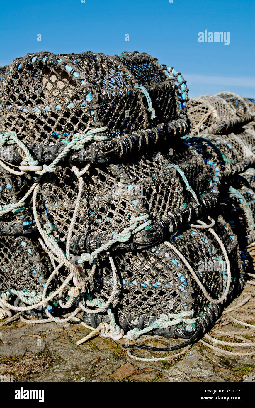 lobster pots on the quay at padstow,cornwall,uk - Stock Image