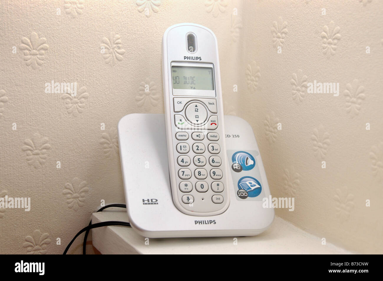 A cordless phone in a corner of a room. - Stock Image