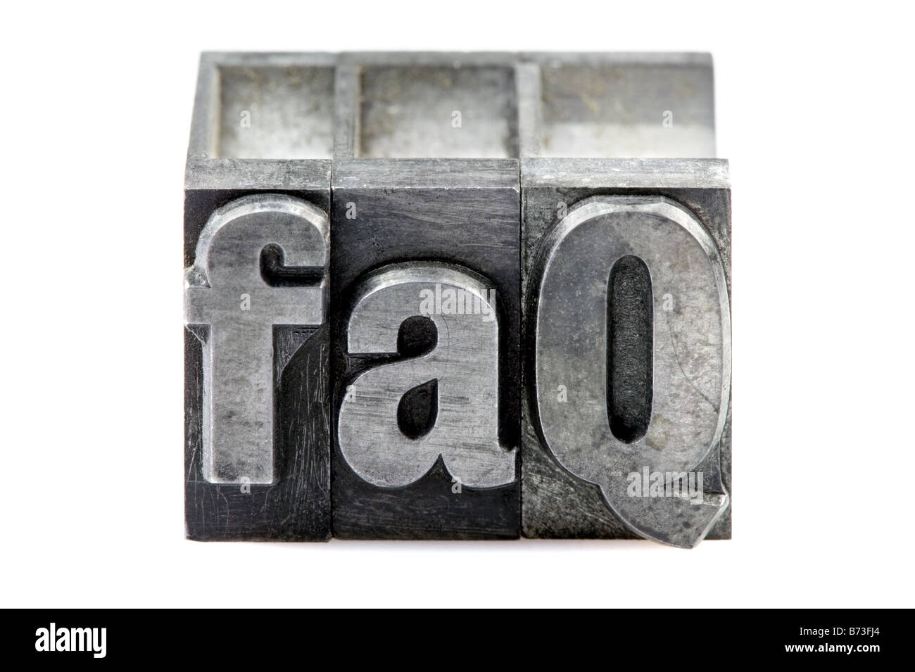 The phrase FAQ in old letterpress printing blocks isolated on a white background - Stock Image