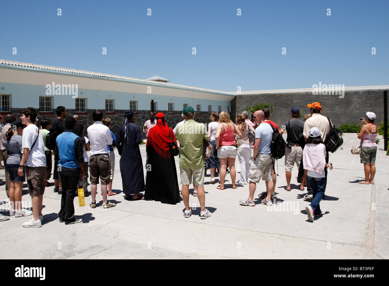 tourist tour group listening to the ex political prisoner guide robben island cape town south africa - Stock Image