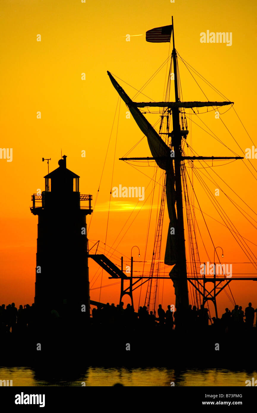 Friends Good Will moves behind the South Haven light on Lake Michigan - Stock Image