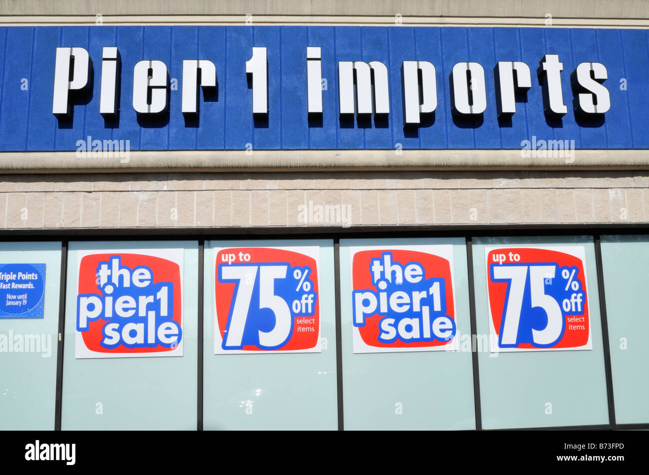 Store sales clearance signs in windows of Pier1 Imports retail store in Hyannis, Massachusetts, USA - Stock Image