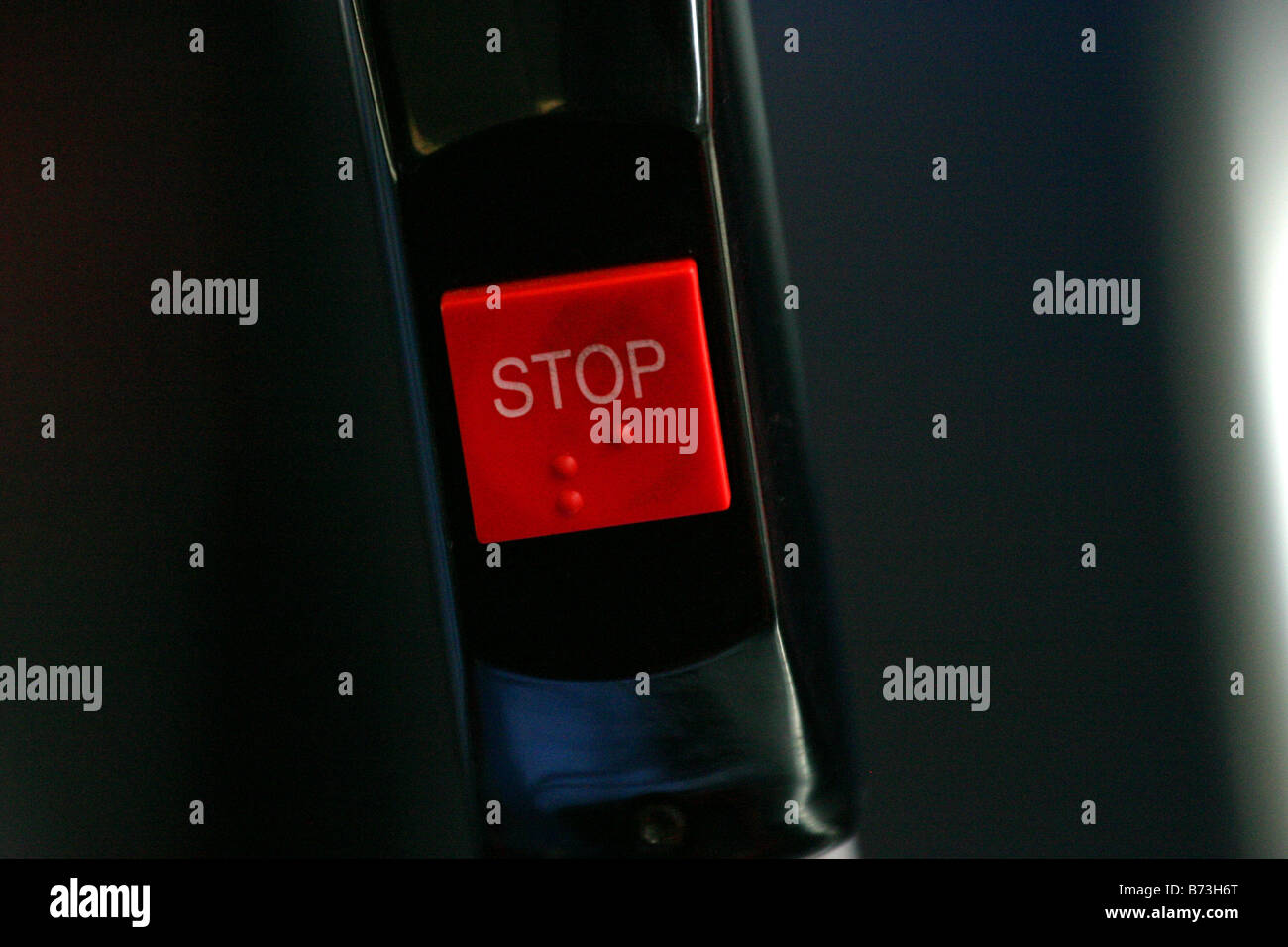 Stop sign in a bendy bus - Stock Image