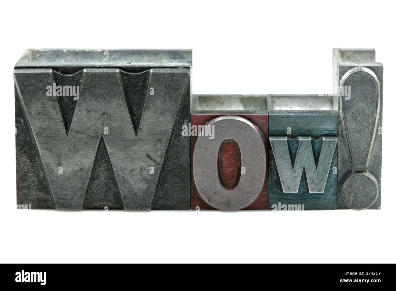The word WOW in old letterpress printing blocks isolated on a white background - Stock Image