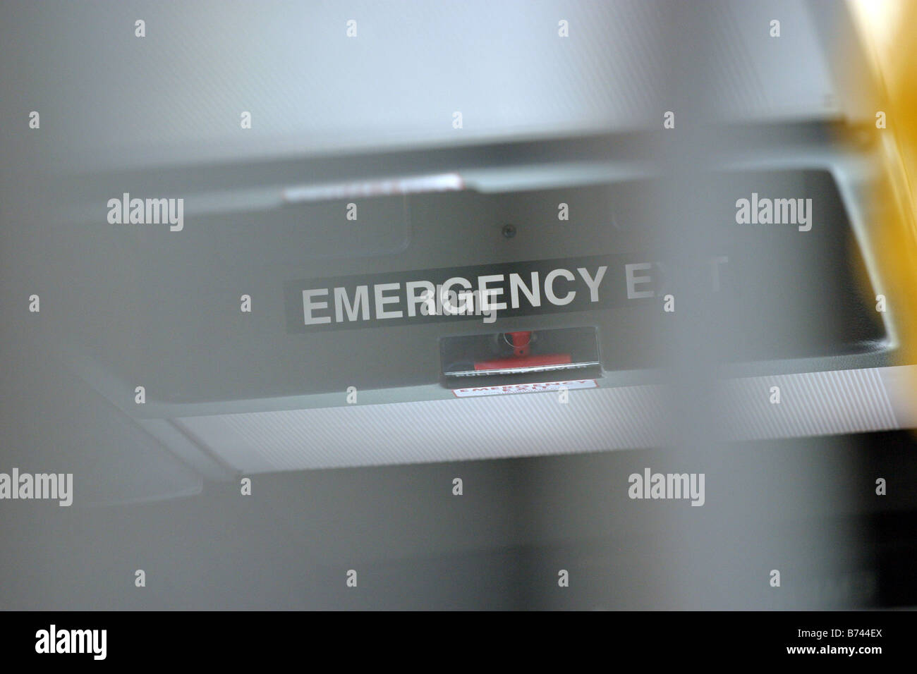 Emergency exit sign  in a bendy bus - Stock Image