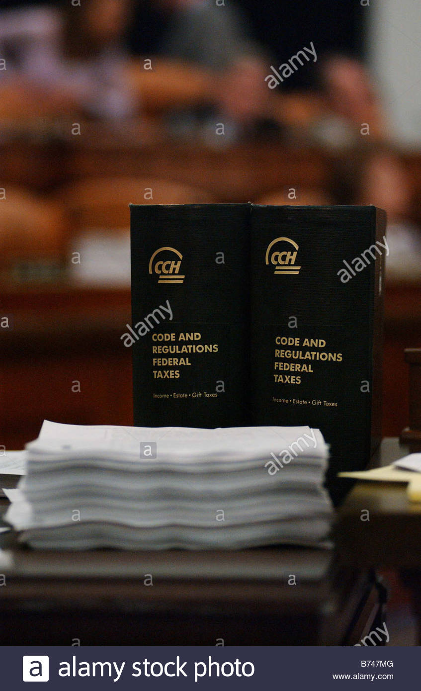 10 05 04 CORPORATE TAX STRUCTURE Code and Regulations Federal Taxes sits at a staffer s desk during the meeting - Stock Image