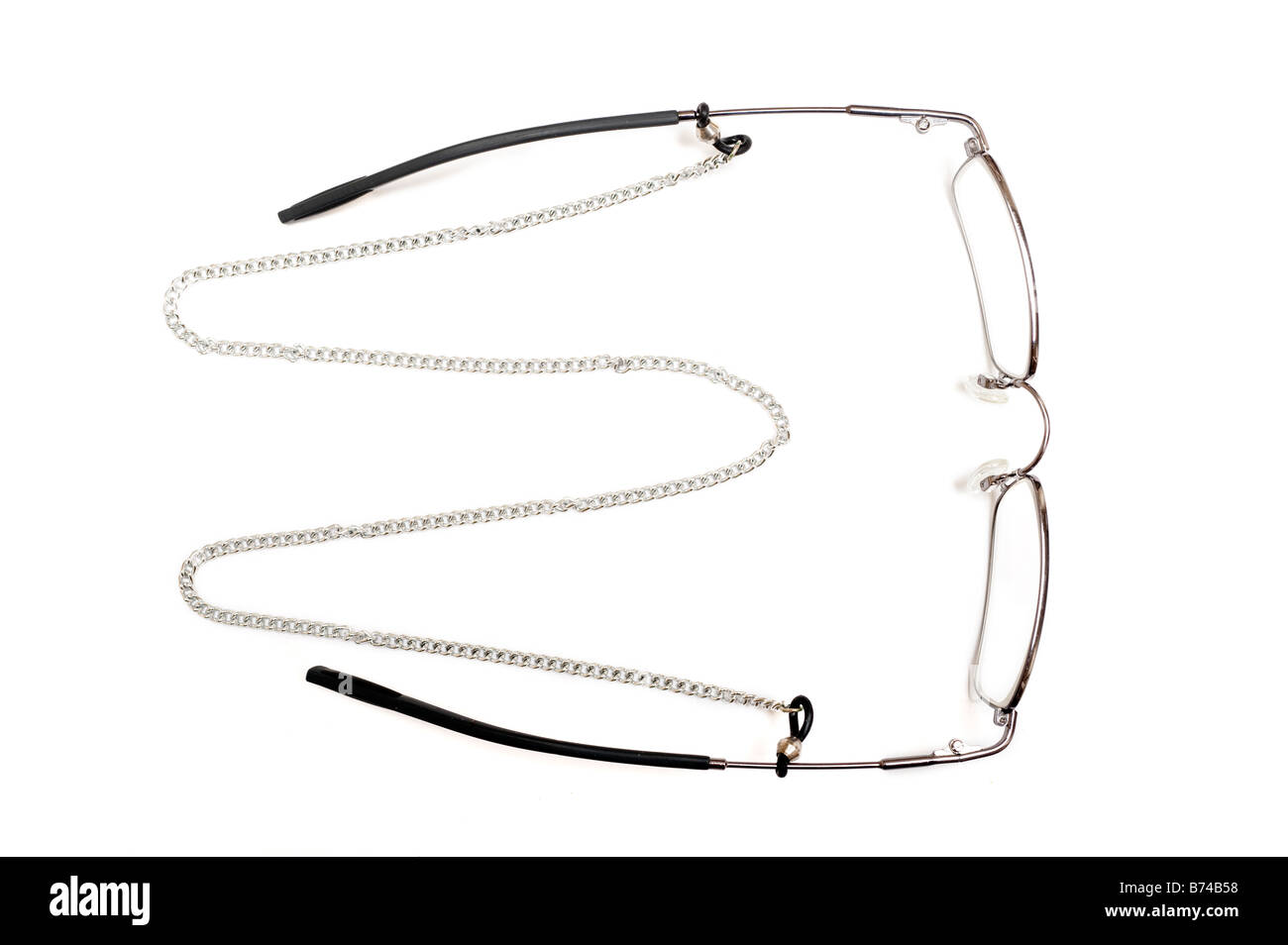 pair of mans spectacles with 'neck chain' - Stock Image