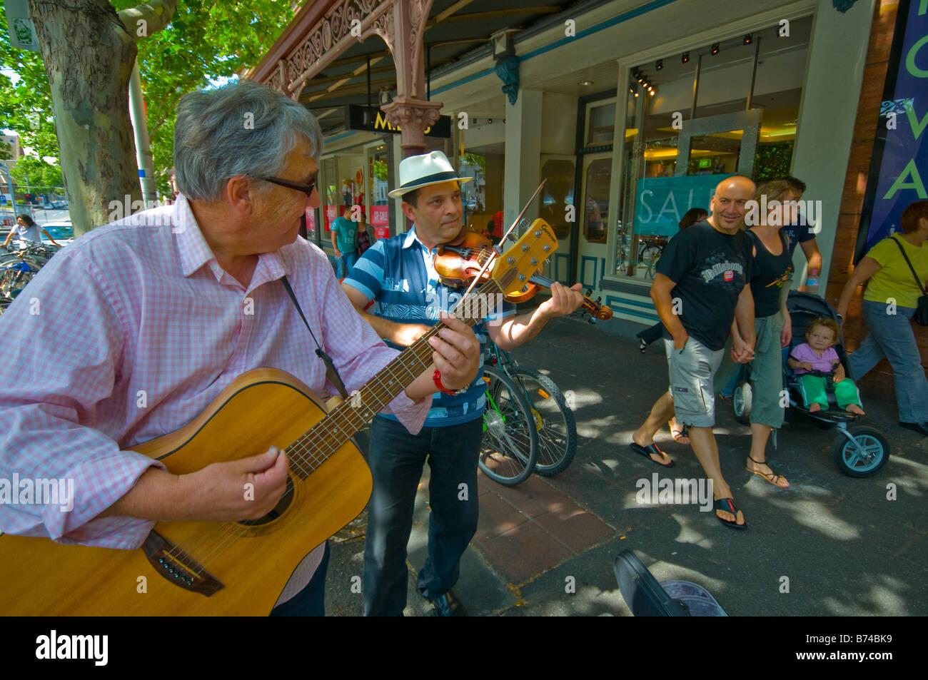Buskers in Lygon Street Melbourne Australia - Stock Image