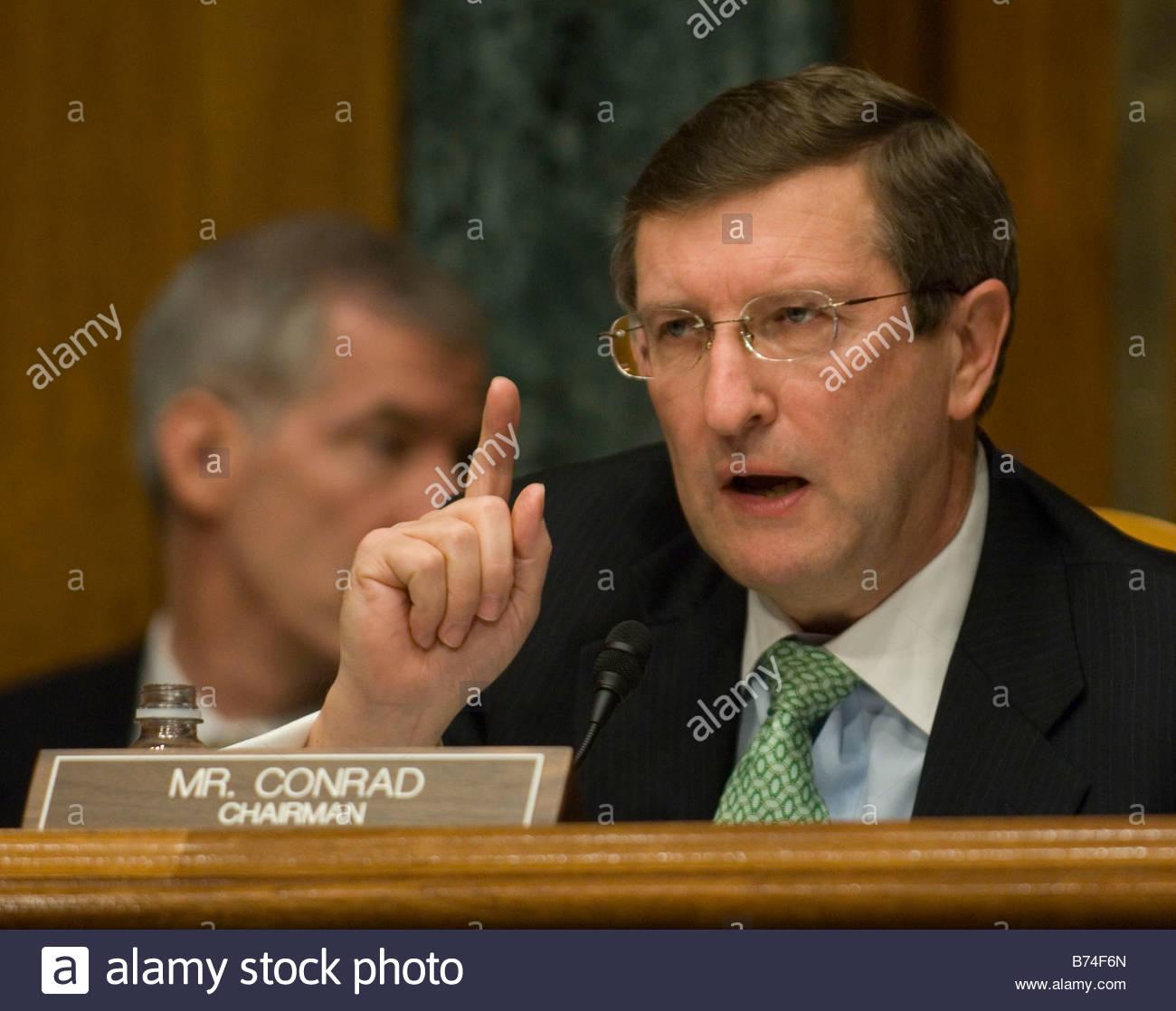 WASHINGTON DC Jan 24 Chairman Kent Conrad D N D questions CBO Director Peter R Orszag during the Senate Budget hearing - Stock Image