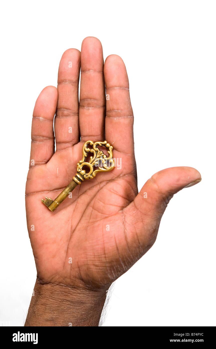 Hand holding old key Stock Photo