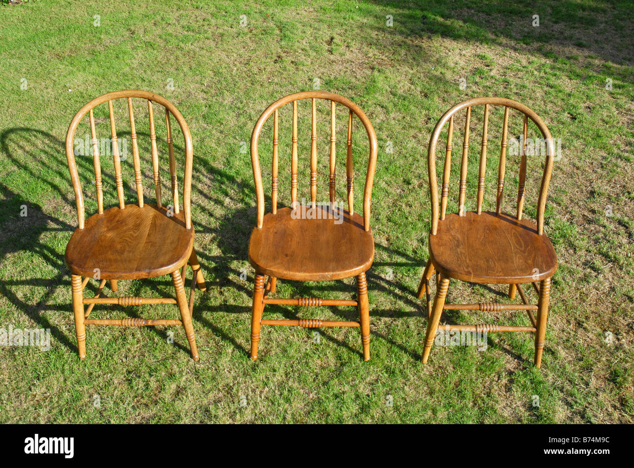 Group Of Three Bentwood Chairs, All Polished, Standing On Grass