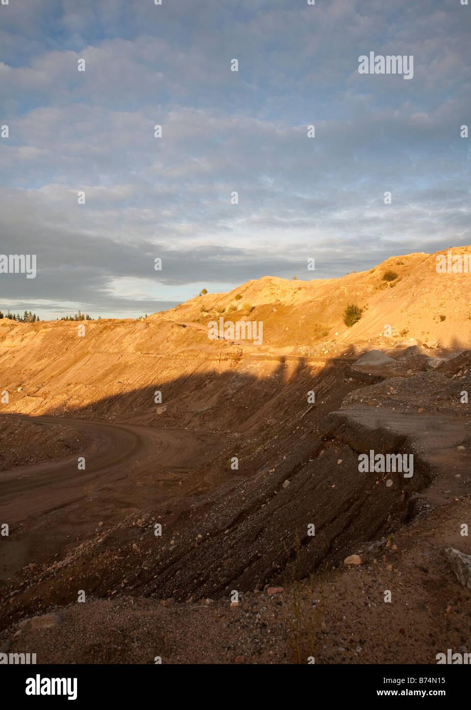 Gravel pit wall on a sandy ridge - Stock Image