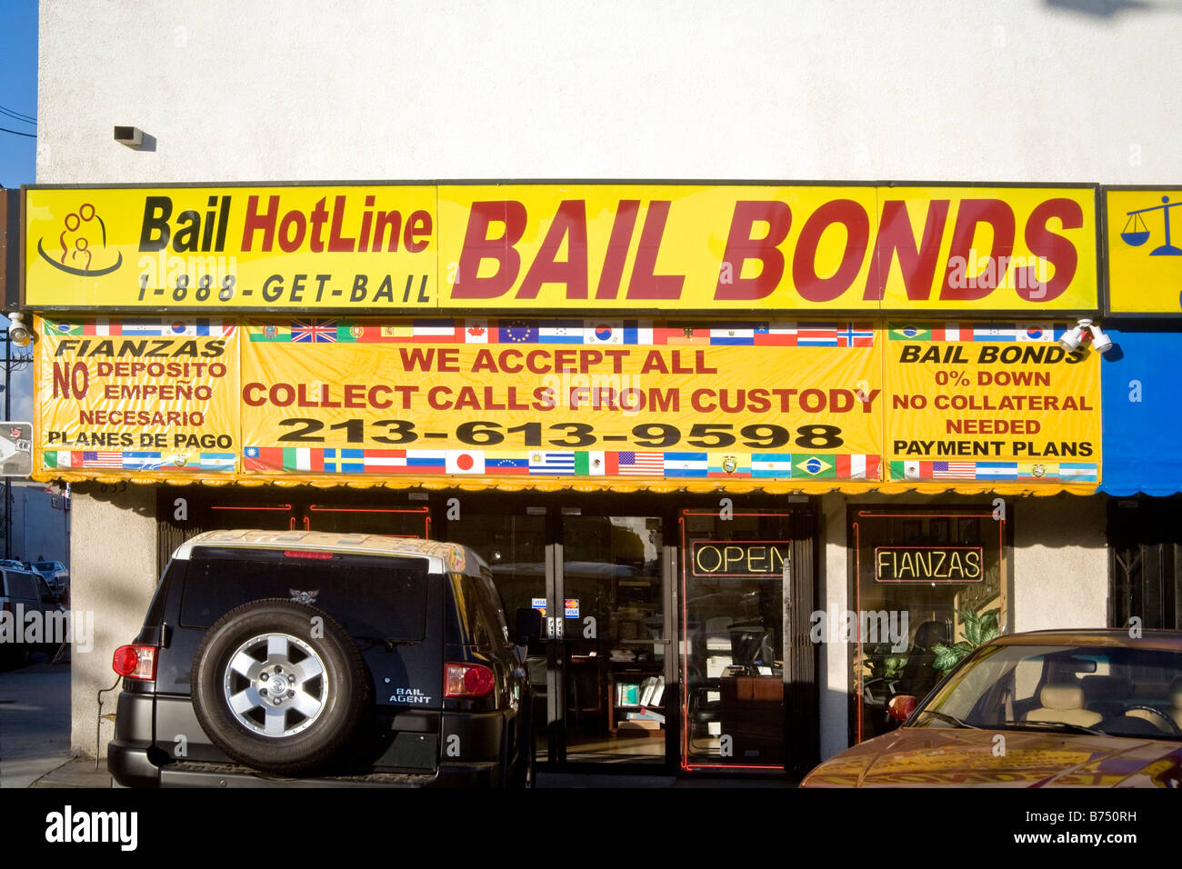 Building with sign Bail Bonds and phone number Los Angeles California - Stock Image