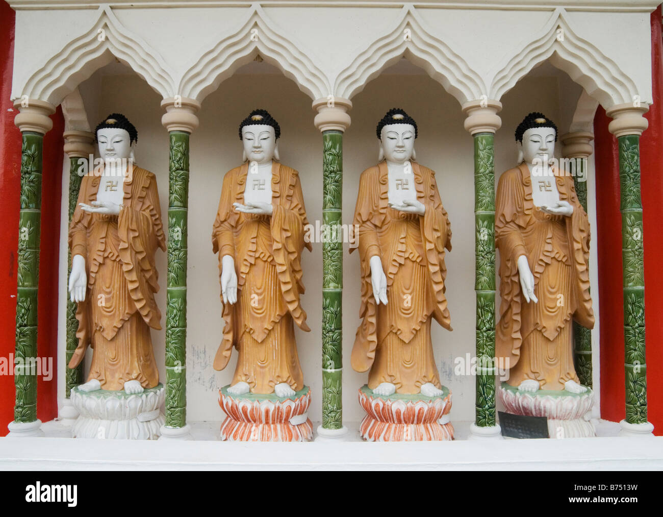 Four standing Buddhas with a left facing swastika on their chest at the Buddhist Kek Lok Si Temple, Air Itam, Penang, - Stock Image
