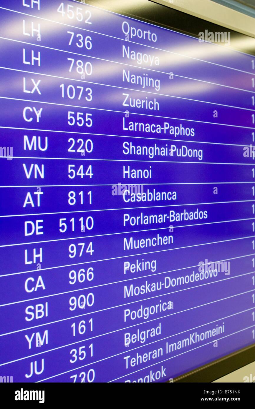 Airport flight departure screen showing international flights schedule Frankfurt Airport Germany - Stock Image
