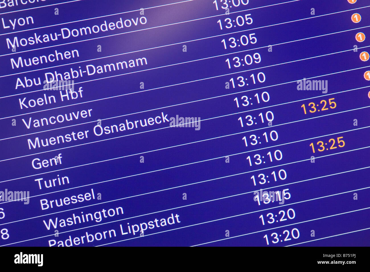 Airport flight departure schedule screen showing international flights with some delayed Frankfurt Airport Germany - Stock Image