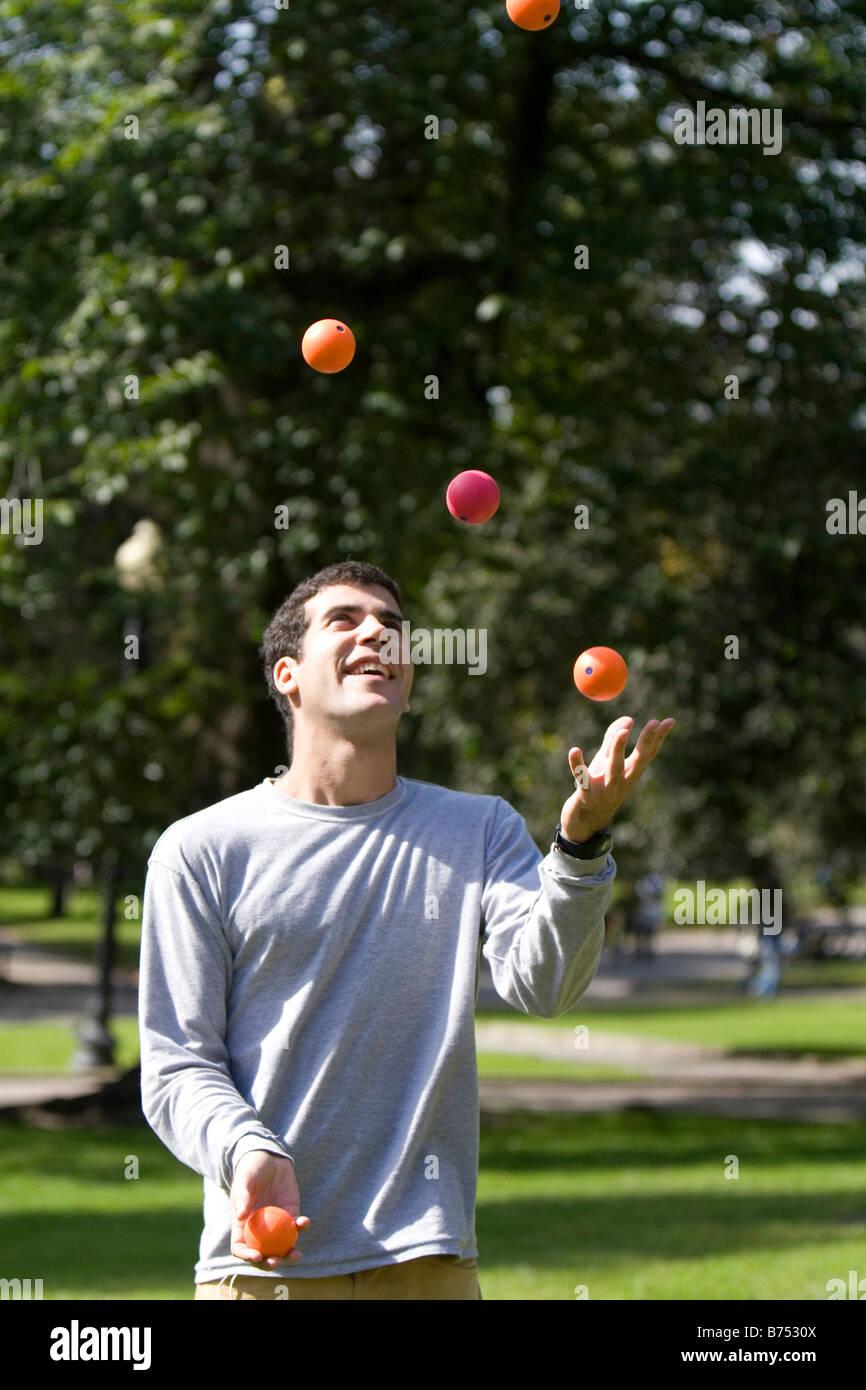 A man toss juggling balls in Boston Common public park in Boston Massachusetts USA - Stock Image