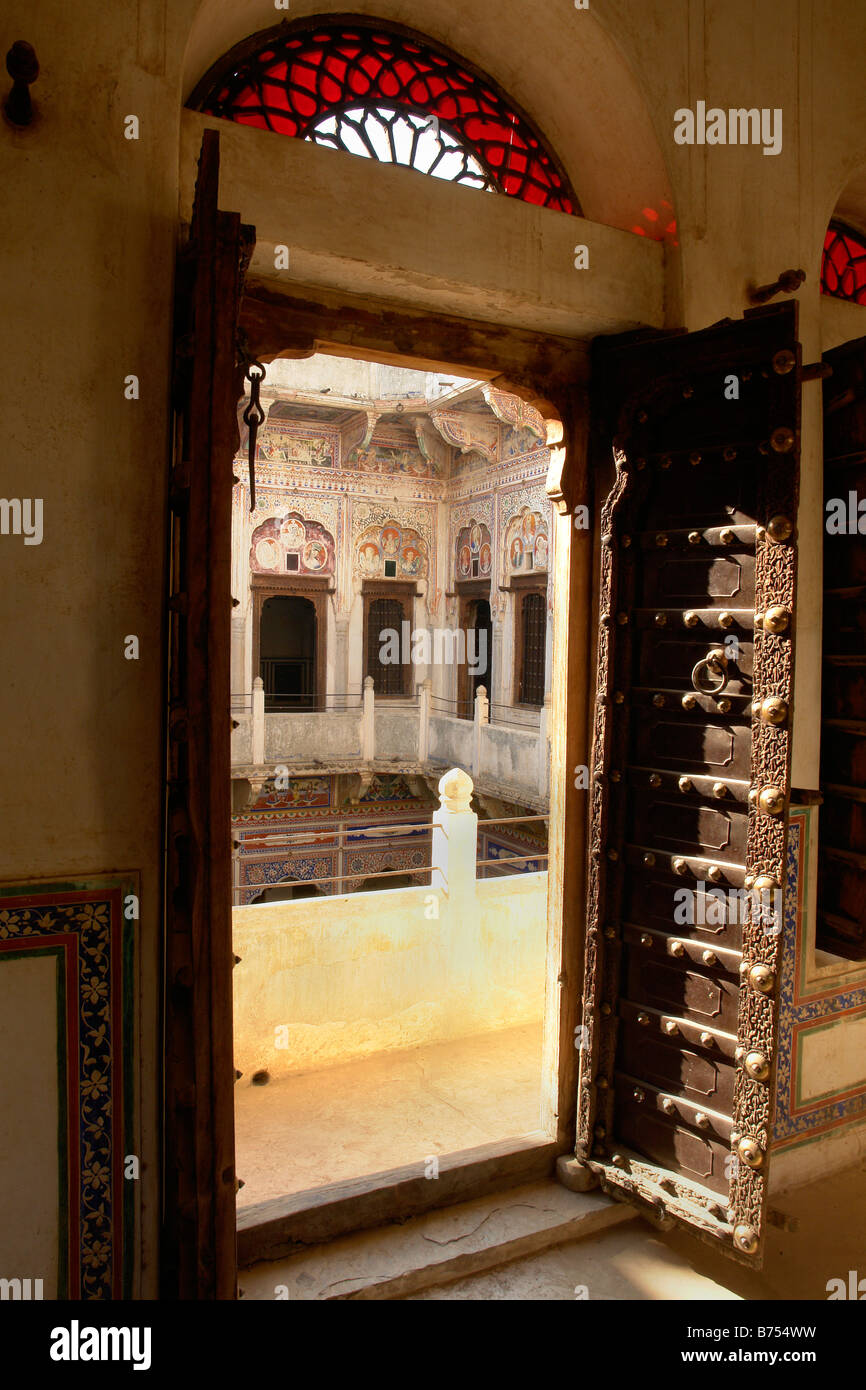 old wooden door looking out into the courtyard of the anandilal poddar haveli or merchants house in nawalgarh & old wooden door looking out into the courtyard of the anandilal ...
