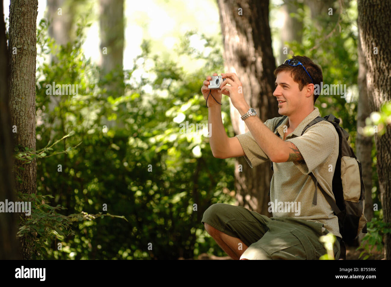 Young man in woods w/ camera, Regina, Saskatchewan - Stock Image