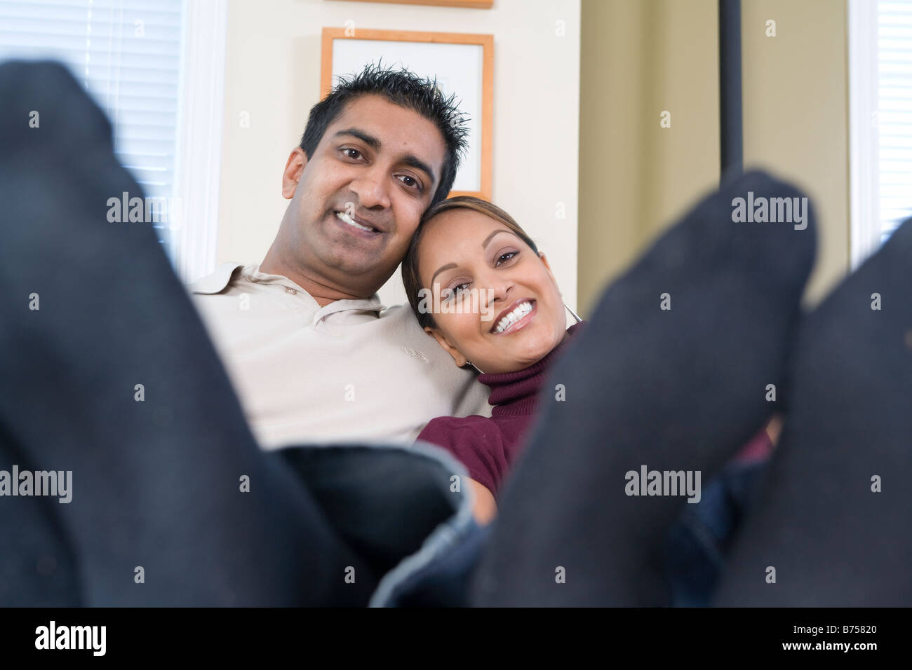 Man and woman with feet up toward camera, Winnipeg, Canada - Stock Image