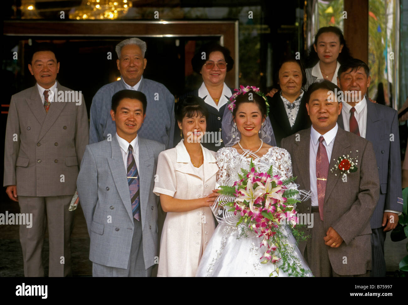 Chinese bride and groom, family members, family portrait, Chinese wedding, wedding, wedding reception, Kunming, - Stock Image