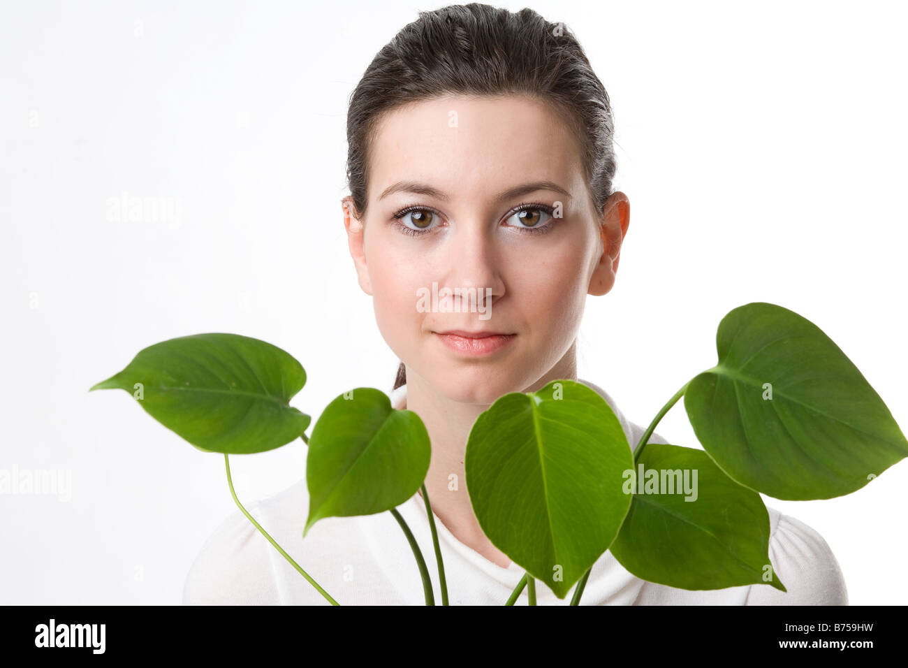 Face of a young woman with leaves, Winnipeg, Manitoba - Stock Image