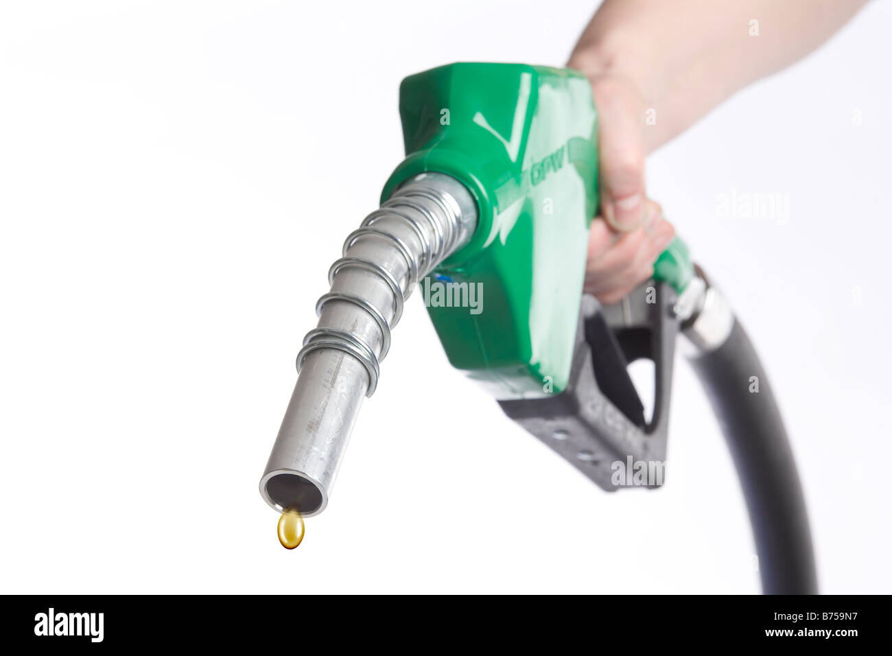 Hand holding nozzle with drop of gasoline coming out, Winnipeg, Manitoba - Stock Image