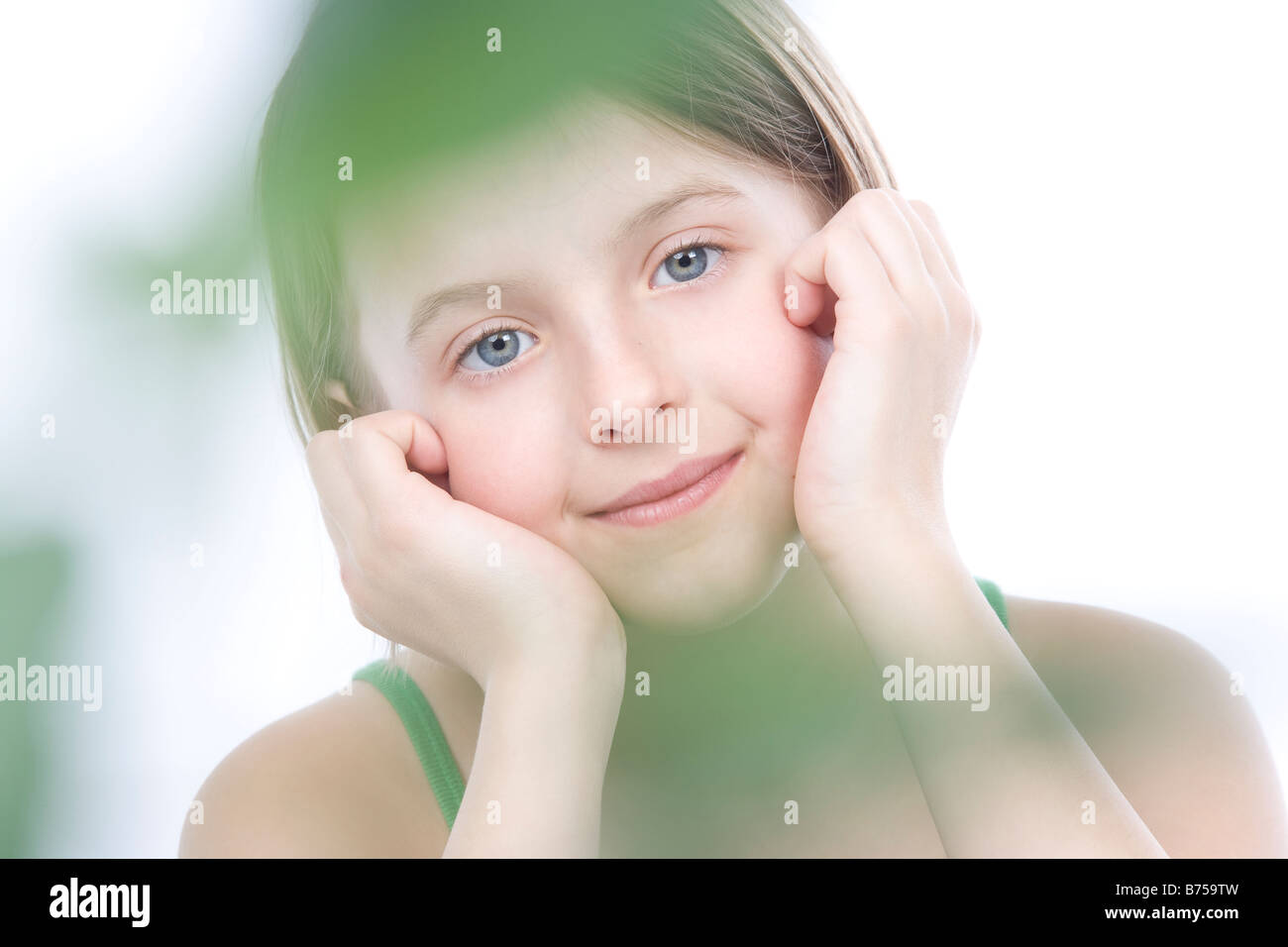 9 year old girl with the green leafs around her, Winnipeg, Manitoba - Stock Image