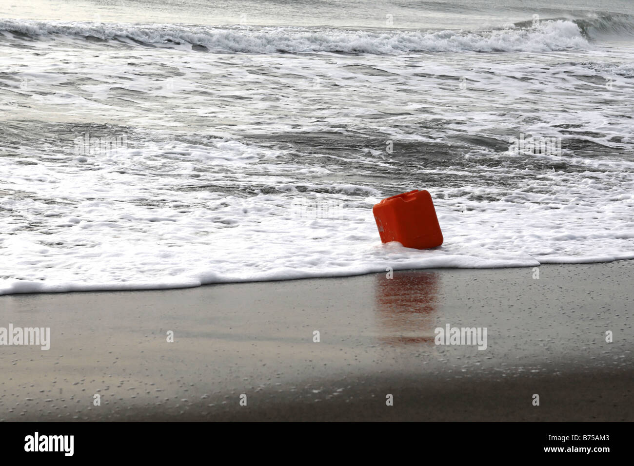 Plastic Container Bottle Washed up on Beach - Stock Image