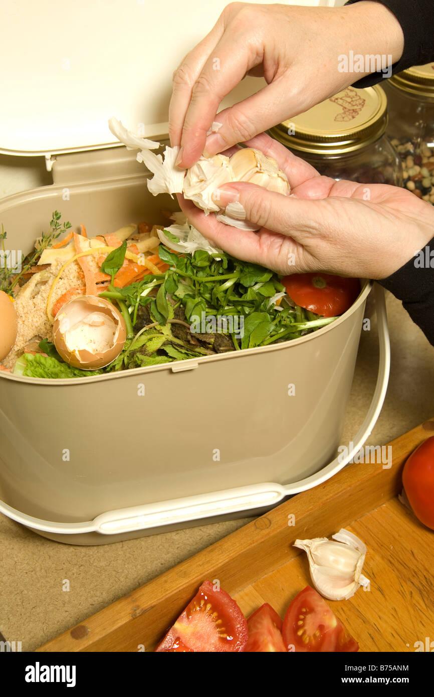 throwing various scraps into kitchen compost pail toronto ontario canada - Kitchen Composting Pail