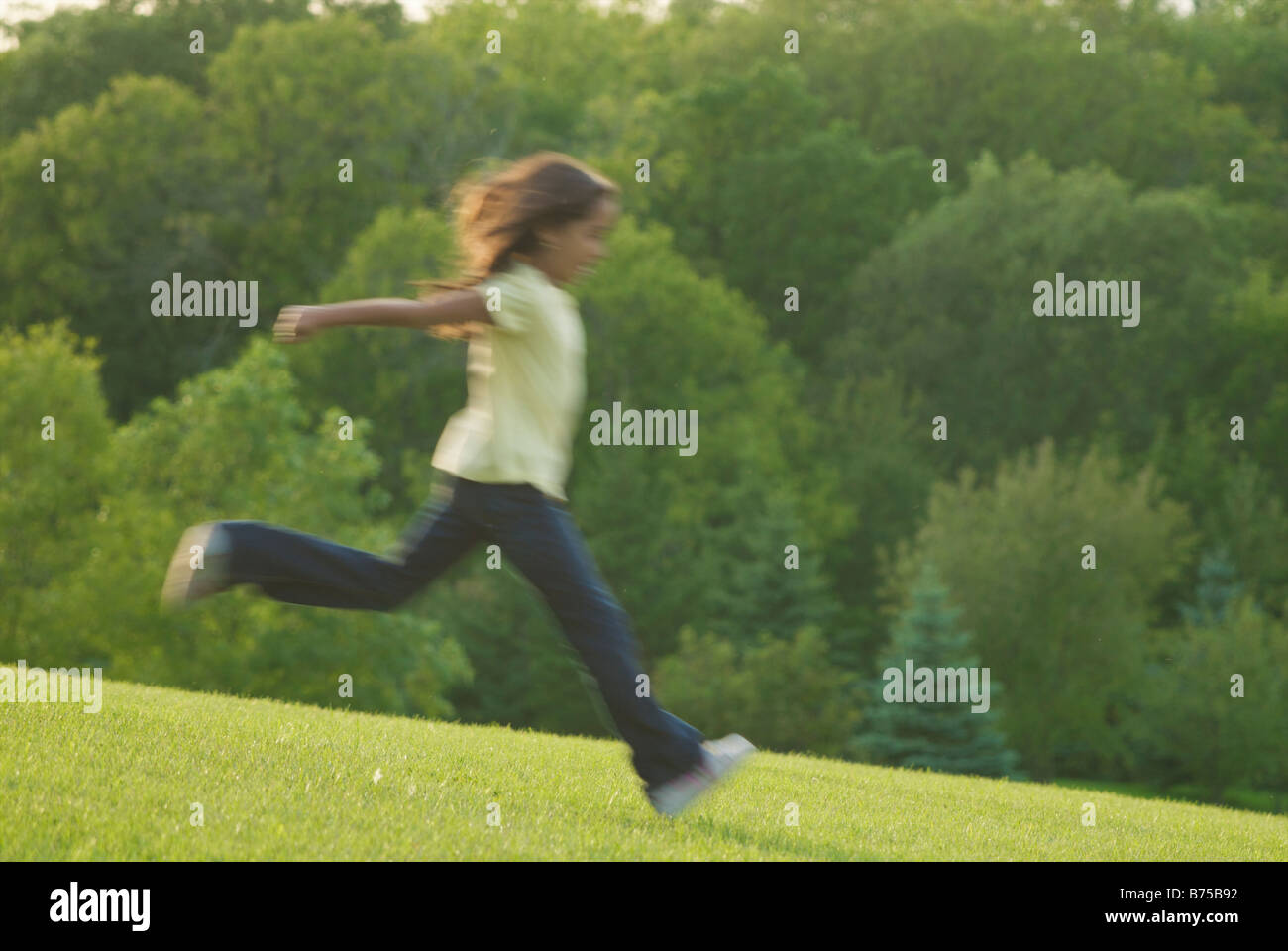 Eight year old girl running, blurred, Winnipeg, Canada Stock Photo