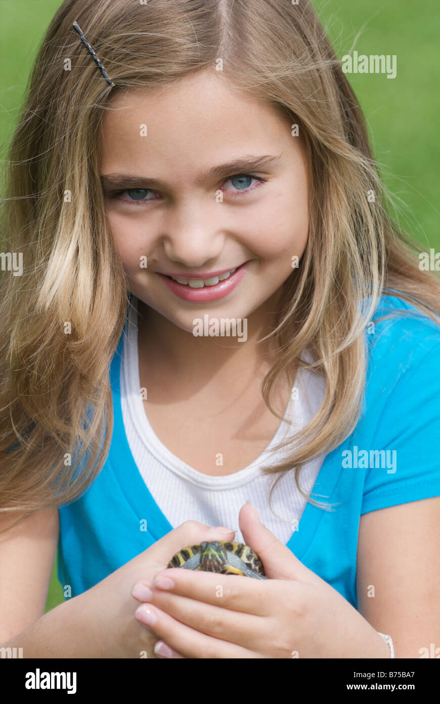 Eight year old girl holding turtle, Winnipeg, Canada - Stock Image