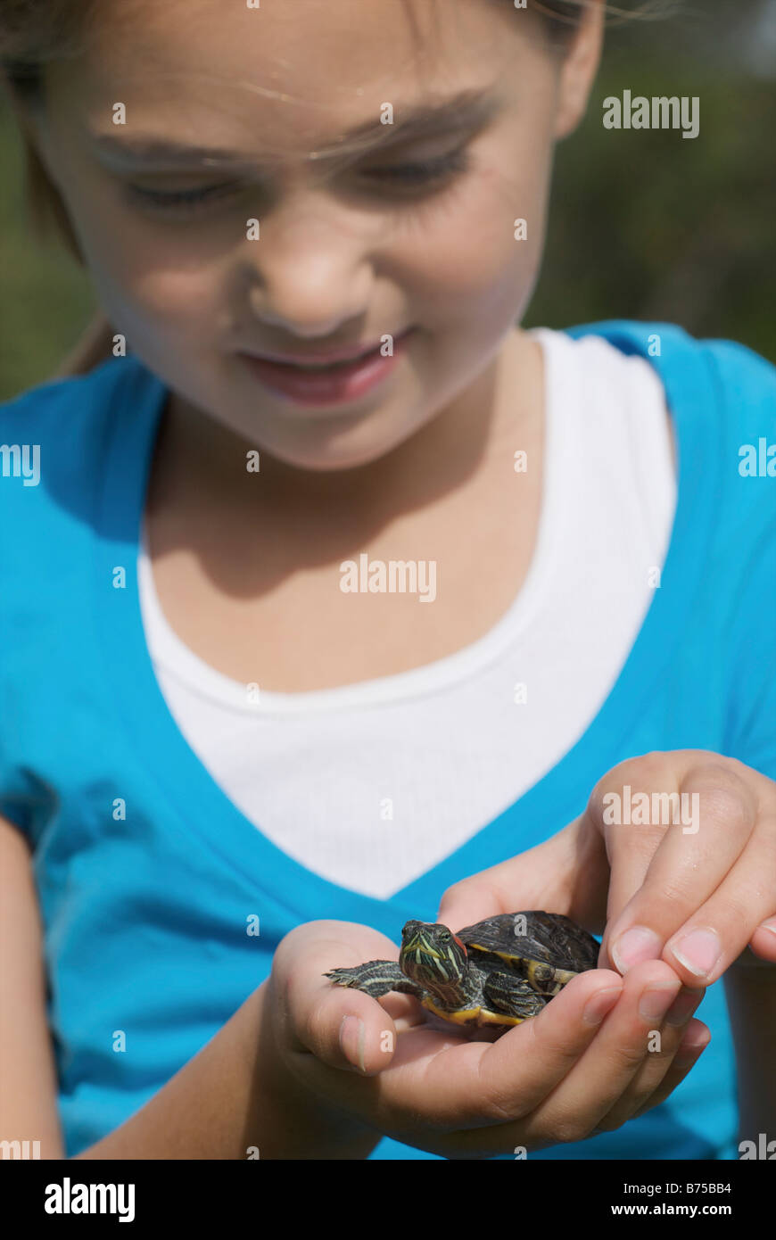 Eight year old girl with turtle, Winnipeg, Canada - Stock Image