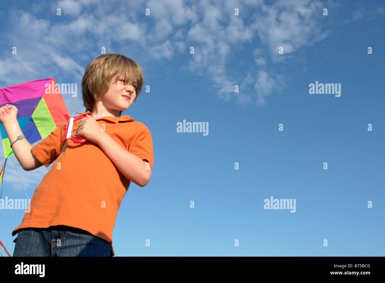 Six year old boy holding kite, Winnipeg, Canada - Stock Image