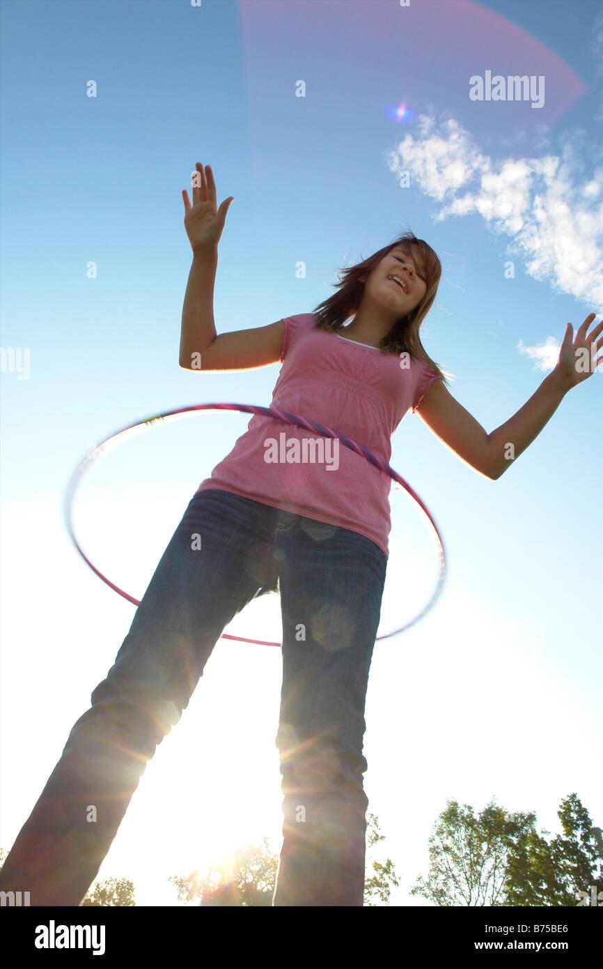 Thirteen year old girl with hula hoop, Winnipeg, Canada - Stock Image