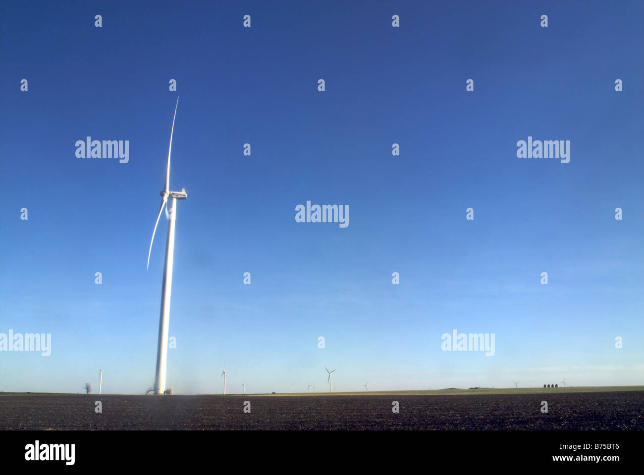 Wind turbines, with other turbines in distance - Stock Image