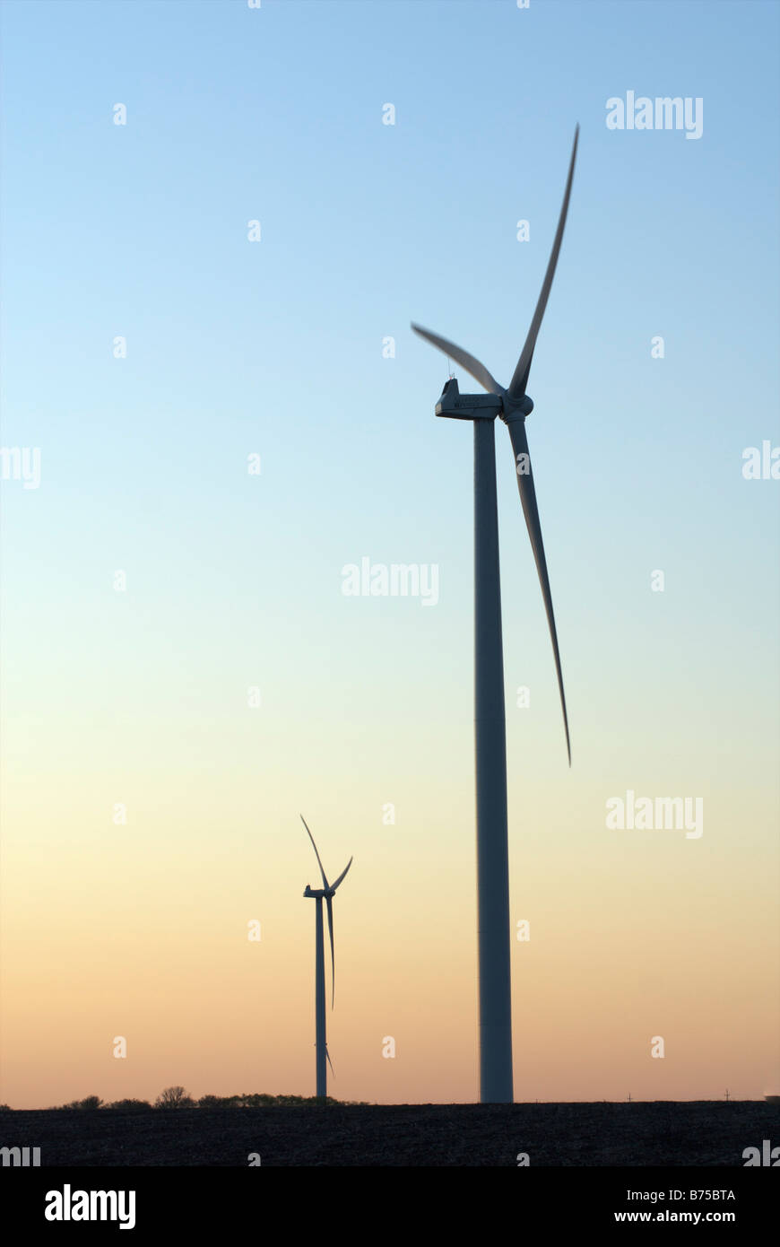 Two wind turbines at sunset - Stock Image